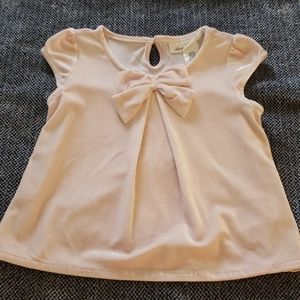Pink H&M flutter top with bow detailing